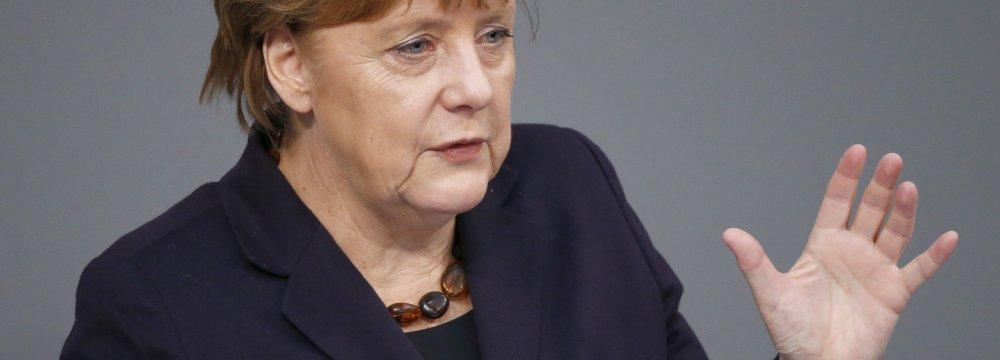 Merkel Questions US Meddling in World Affairs