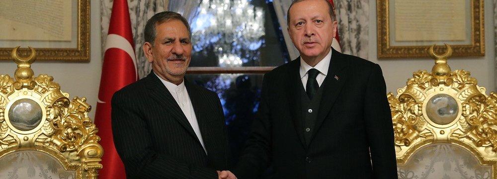 Turkish President Recep Tayyip Erdogan (R) meets Vice President Es'haq Jahangiri in Istanbul on Oct. 20.