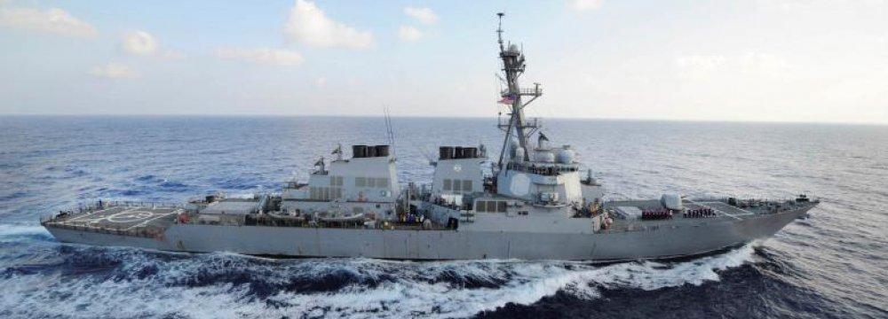 US Vessel Fires Warning Shots at Iranian Boats