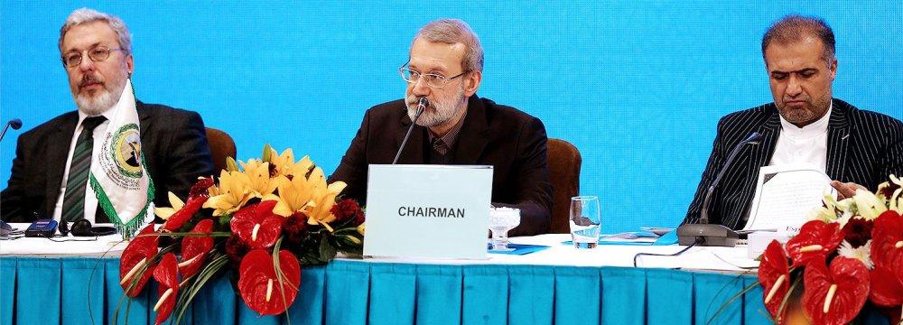 Majlis Speaker Ali Larijani (C) addresses an international meeting on Palestine in Tehran on Dec. 18.