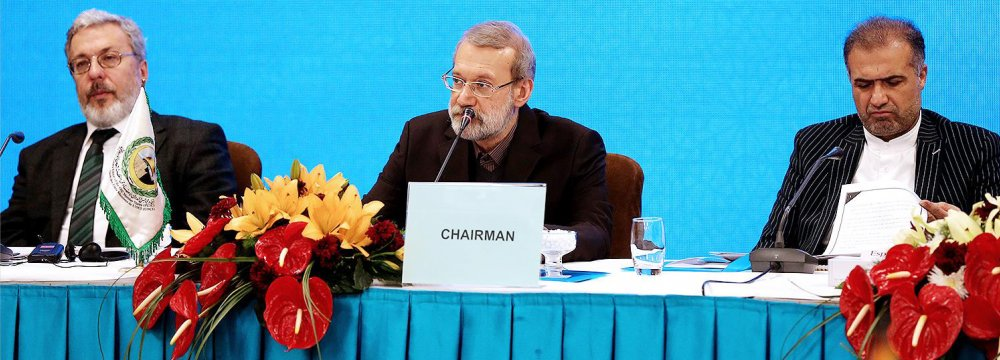 Majlis Speaker Ali Larijani (C) addresses an international meeting on Palestine in Tehran on Dec. 18.