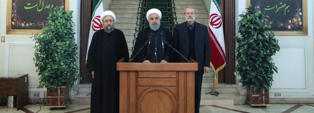 President Hassan Rouhani is flanked by Majlis Speaker Ali Larijani (R) and Judiciary Chief Sadeq Amoli Larijani in Tehran on Nov. 11.