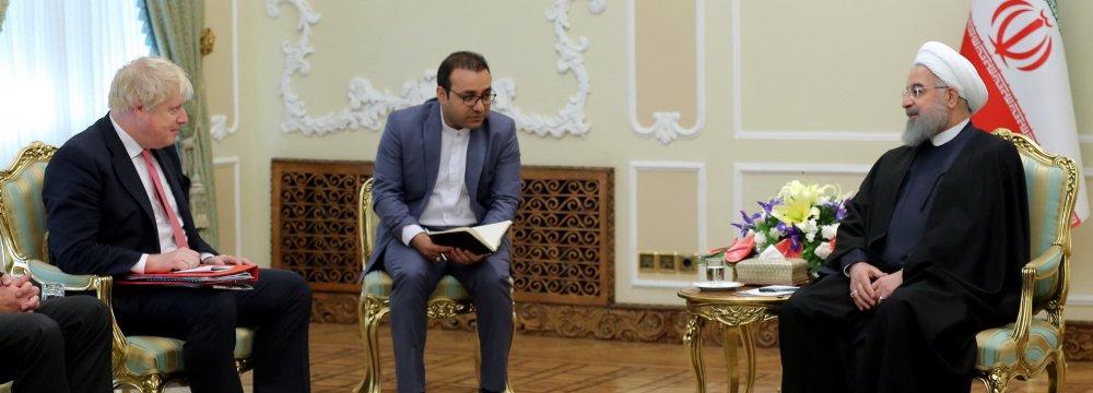British Foreign Secretary Boris Johnson (L) meets President Hassan Rouhani in Tehran on Dec. 10.