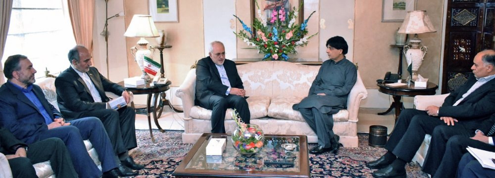 Foreign Minister Mohammad Javad Zarif meets Pakistani Interior Minister Chaudhry Nisar in Islamabad on May 3.