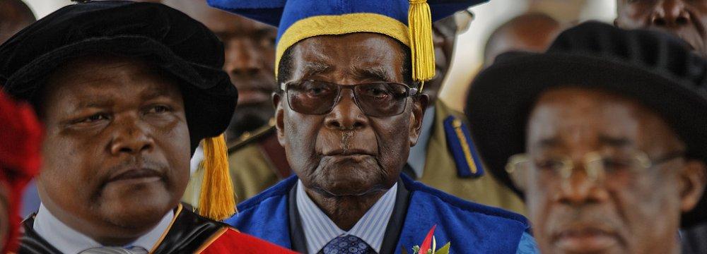 Zimbabwe's President Robert Mugabe (C) arrives to preside over a student graduation ceremony at Zimbabwe Open University in Harare, Zimbabwe, Nov. 17.