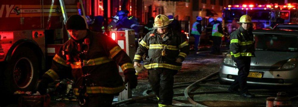 NY Fire Kills 12, Sends Residents Scrambling