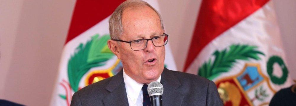 Peru's President Narrowly Escapes Impeachment Over Bribery Scandal