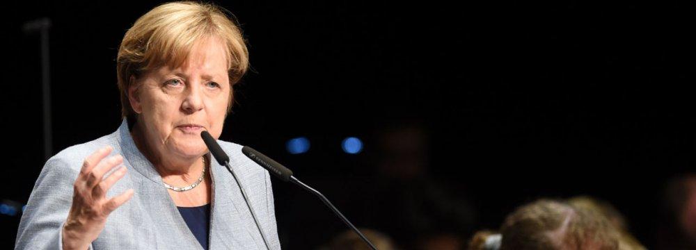 Weakened Merkel Seeking Compromise in Coalition Talks