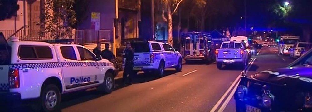 Australian counter-terrorism police conduct raids across Sydney suburbs on July 30.