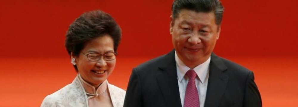 Hong Kong Chief Executive Carrie Lam (L) and Chinese President Xi Jinping walk after Lam took her oath, July 1.