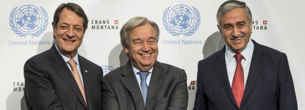 Nicos Anastasiades (L), Antonio Guterres (C) and Mustafa Akinci