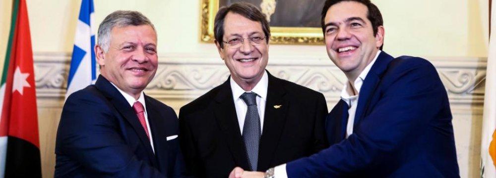 Cypriot President Nicos Anastasiades (C), Greek Prime Minister Alexis Tsipras (R) and Jordan's King Abdullah