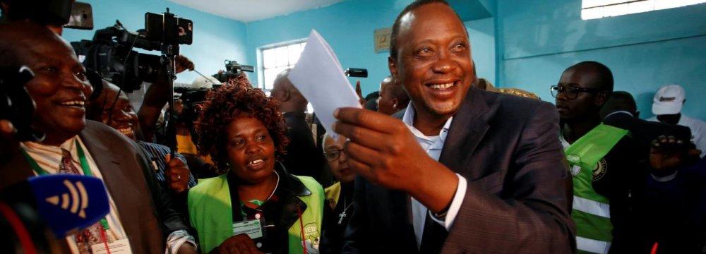 President Uhuru Kenyatta casts his ballot inside  a polling station in his hometown of Gatundu  in Kiambu county, Kenya on August 8.
