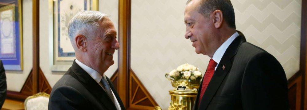 Turkish President Recep Tayyip Erdogan meets with US Defense Secretary Jim Mattis at the Presidential Palace  in Ankara on August 23.