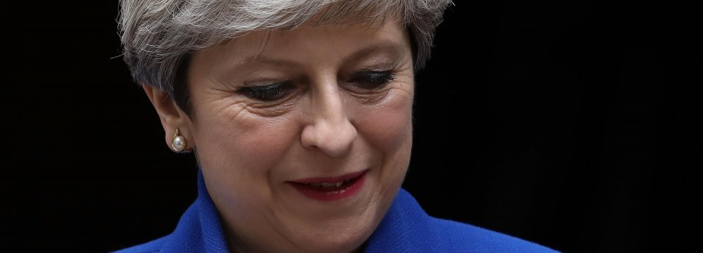Theresa May Appoints Ministers to Her Shaky Gov't