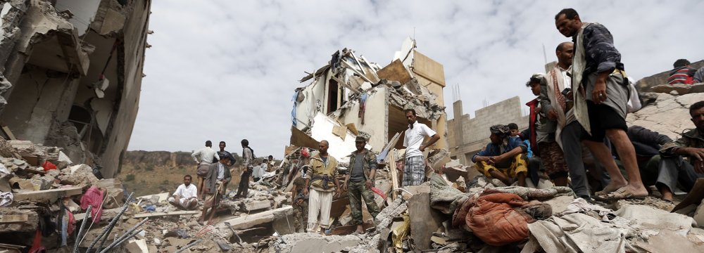 Yemenis search under the rubble of a house destroyed in a Saudi-led airstrike in the capital Sanaa on August 25.
