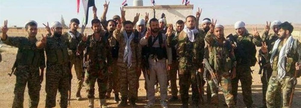Syrian soldiers celebrating their victory (File Photo)