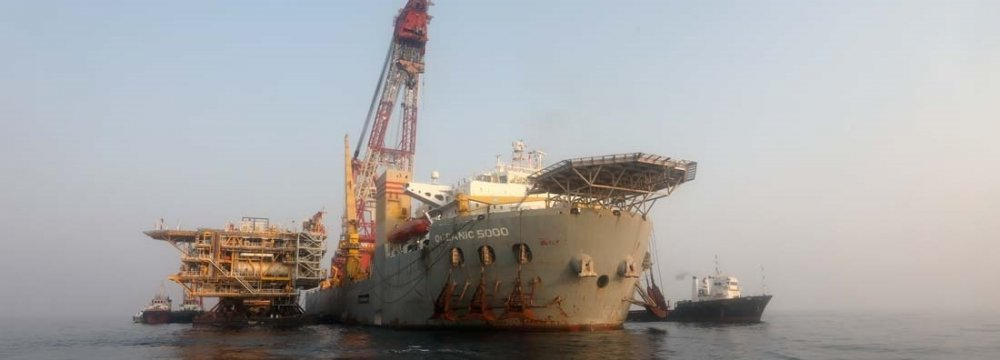 [An offshore South Pars platform undergoing installation in the Persian Gulf.