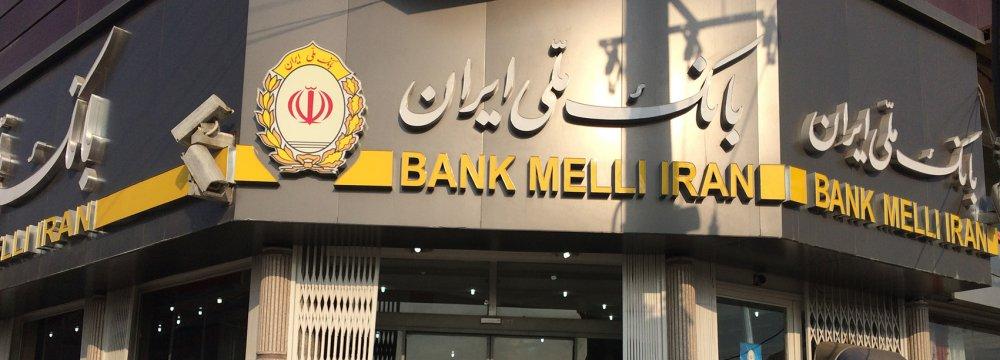 Commercial Banks'  Arrears to CBI Halved