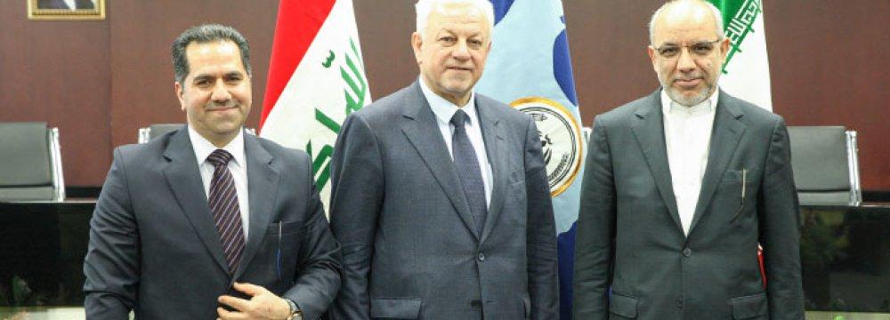 Mohammad Kazem Choghazardi (L) and Rajeh Saber Abboud al-Mousavi(C)