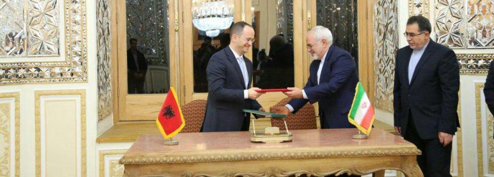 Ditmir Bushati (L) and Mohammad Javad Zarif