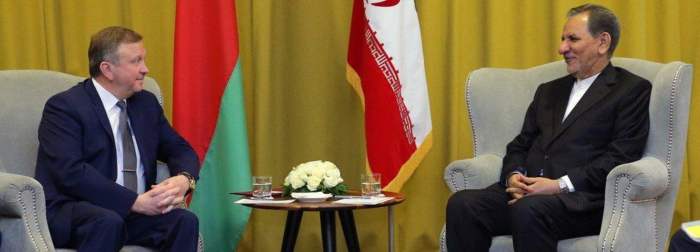 First Vice President Es'haq Jahangiri (R) meets Belarus Prime Minister Andrei Kobyakov.