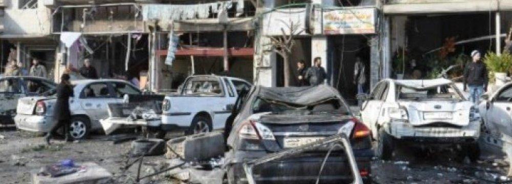 Suicide Attacks Kill  Dozens in Homs