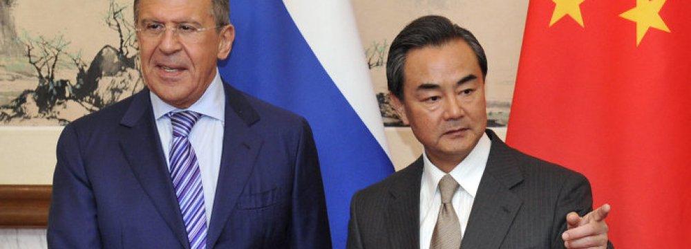 Wang Yi (R) and Sergey Lavrov