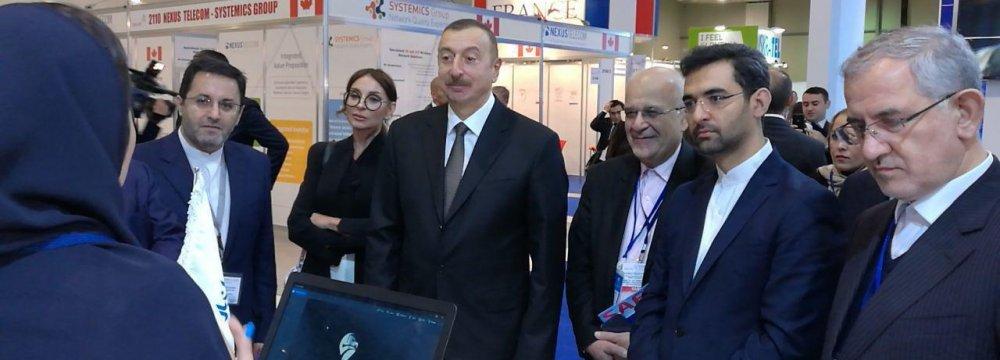 Azerbaijani President Ilham Aliyev (C) and Iran's Telecoms Minister Mohammad Javad Azari Jahromi (1st R) visited Asan Bar's booth at Bakutel 2017.