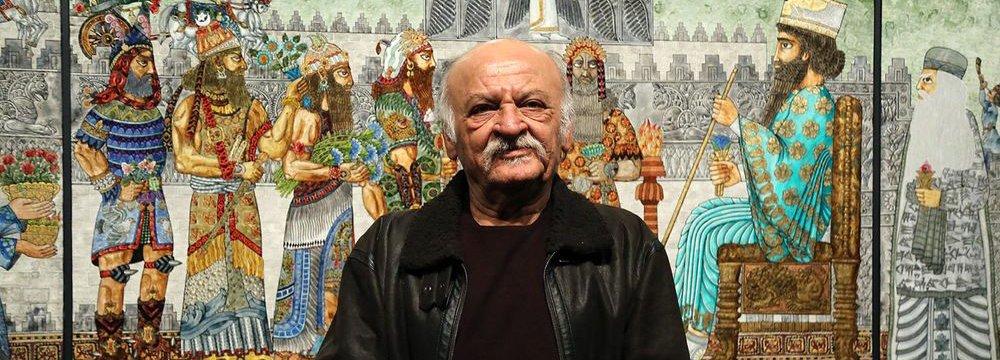 Ali Akbar Sadeghi standing before his work