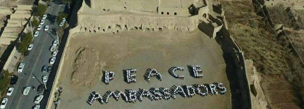 """Tour guides formed a human chain to spell out the words """"Peace Ambassadors""""."""