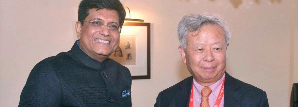 Piyush Goyal (L) and Jiu Liqun meet prior to the AIIB seminar in Mumbai on Monday.