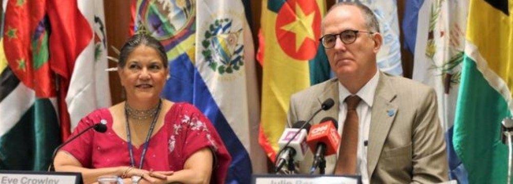 FAO regional representative Julio Berdegue (R), and the deputy regional representative Eve Crowley.