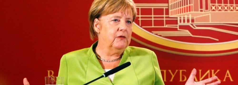 Merkel Targets Debt Reduction, Investment