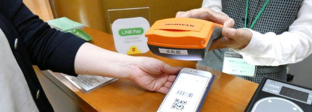 Amazon, SoftBank Vie to Make Japan Cashless