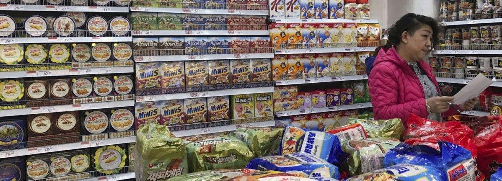 China Cuts Import Tariffs to Lift Consumption