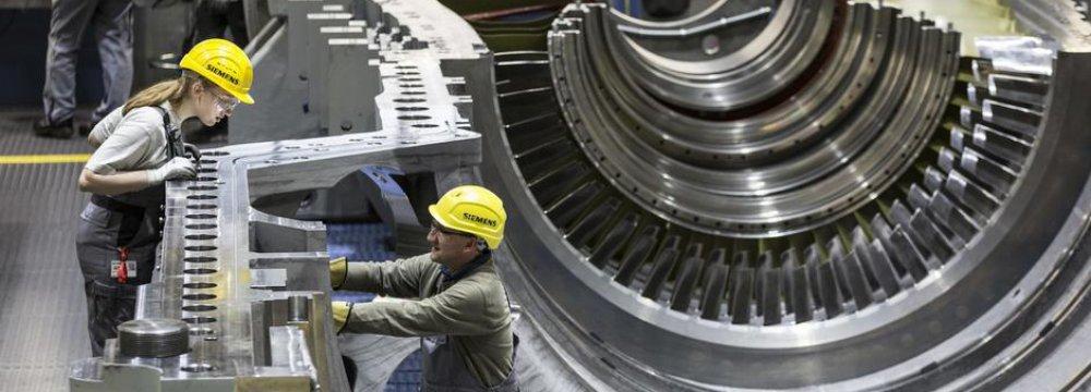 German Economy Powers Ahead, a Boost for Merkel