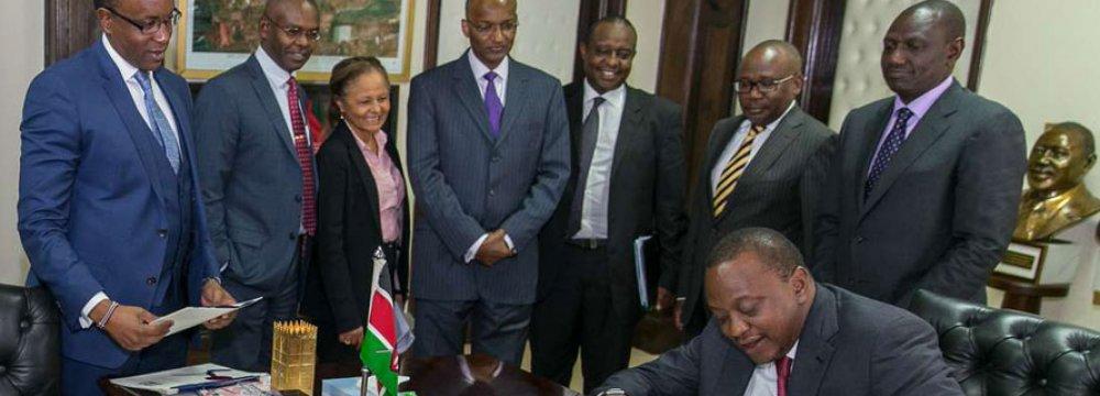 President Uhuru Kenyatta signed the interest rate bill  in Nairobi on August 24, 2016.
