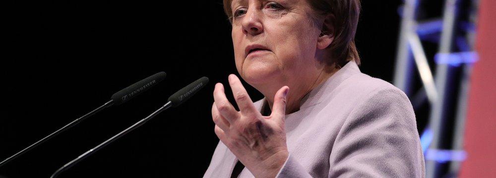 Merkel Rebuffs Critics of Trade Surplus