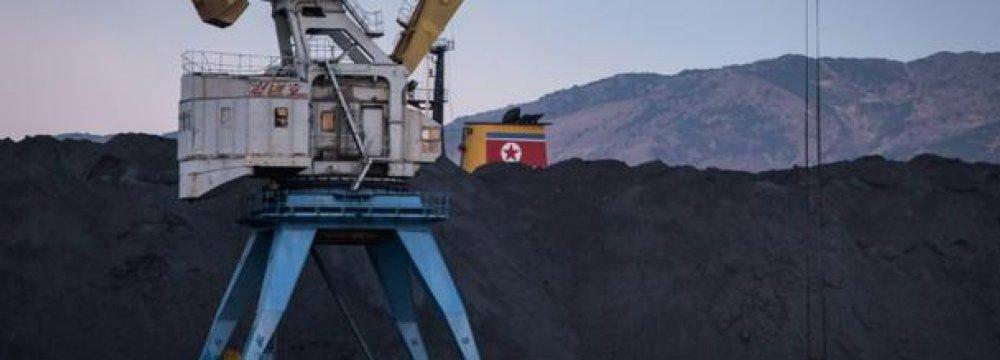 A mound of unsold North Korean coal at Rajin harbor.