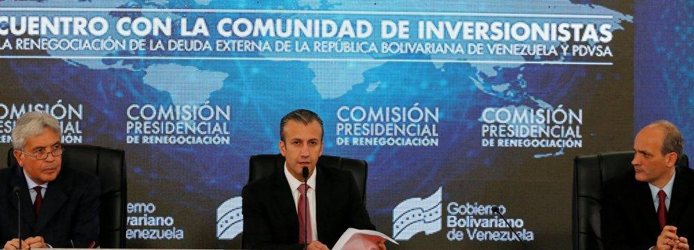 Tareck El Aissami (C) offered bondholders no concrete proposals for debt restructuring.