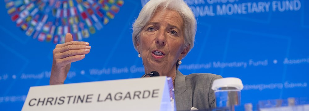 IMF Managing Director Christine Lagarde speaks during a press conference during the World Bank Group / International Monetary Fund Annual Meetings at IMF Headquarters in Washington, DC, October 12.