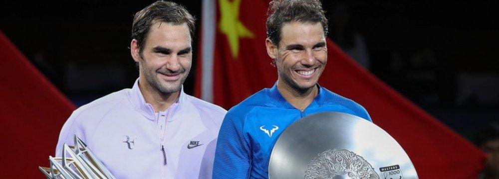 Roger Federer (L) and Rafa Nadal