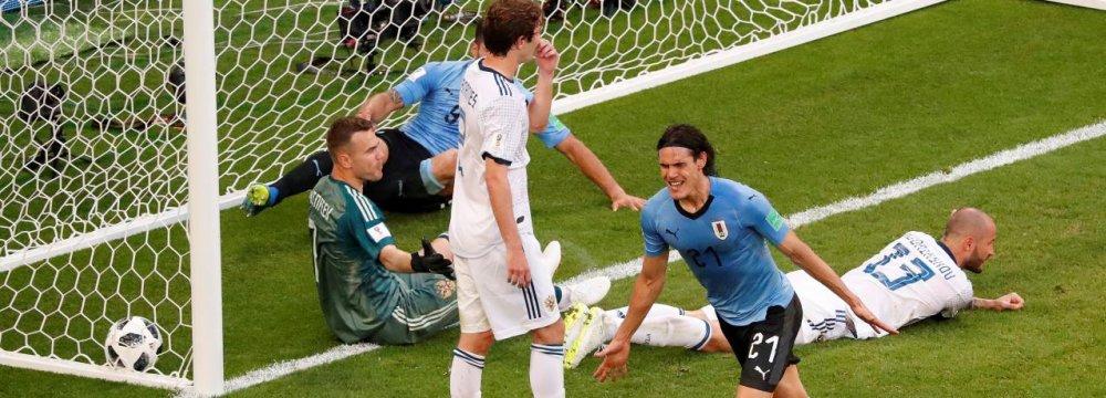 Uruguay's Edinson Cavani celebrates scoring his team's  third goal against Russia.