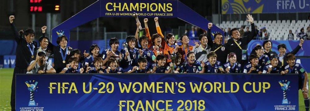 Japan celebrates during the awarding ceremony on Friday.