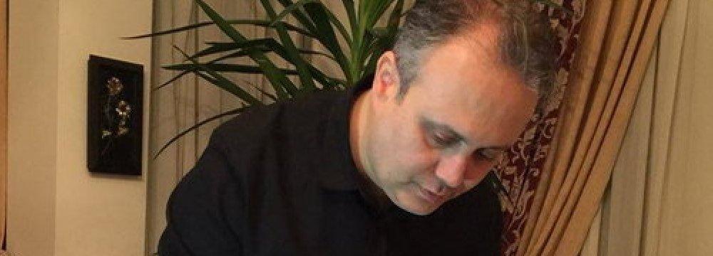 Ramin Hajian Fard turning the pages of  the encyclopedia
