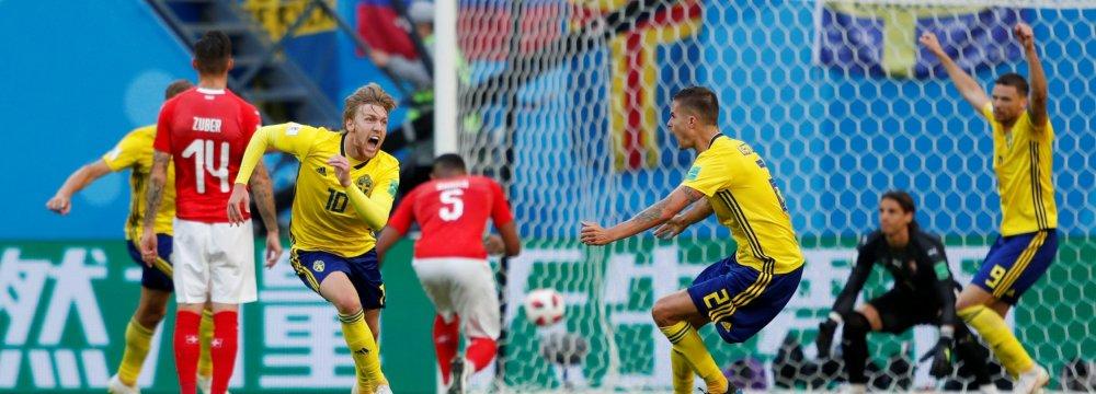Sweden's Emil Forsberg (No. 10) celebrates scoring his side's only goal against Switzerland.