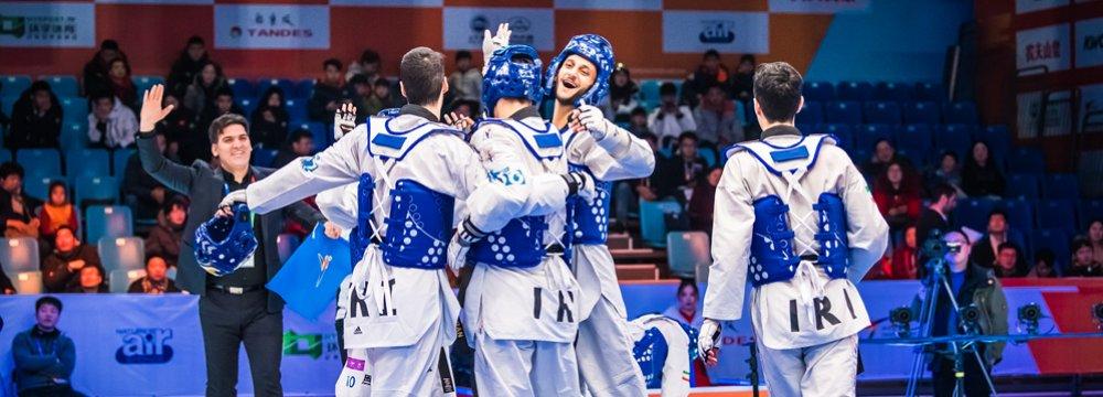Iranian taekwondokas celebrating victory