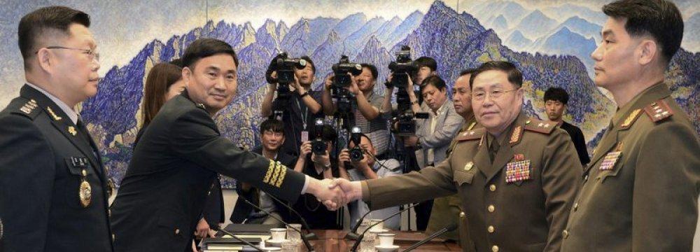 Two Koreas Discuss Reducing Military Tension
