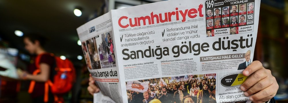 "The Cumhuriyet opposition newspaper ran a headline focused on alleged vote violations: ""A shadow fell over the ballot boxes"""